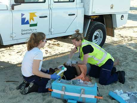 University of the Sunshine Coast Bachelor of Paramedic Science students working on 'patients' from a simulated vehicle rollover during a recent training event on Fraser Island.