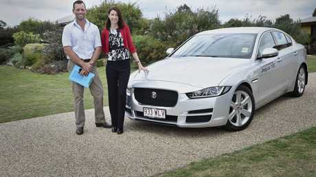 Garden judge Clint Kenny and The Chronicle Garden co-ordinator Kristy Hayes with the Jaguar car being used for garden judging of the Chronicle Garden Competition.