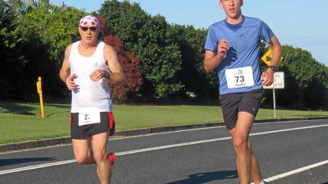 Ultra marathon man Martin Lambert (left) surges on the hills with PB award winner Hayden Connor.