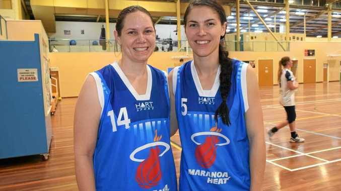SLAM DUNK: Samantha Burey and Hannah Christensen are trying out ladies basketball.