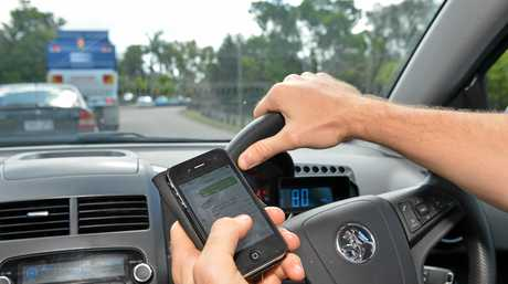 Texting while driving. Photo: Warren Lynam / Sunshine Coast Daily