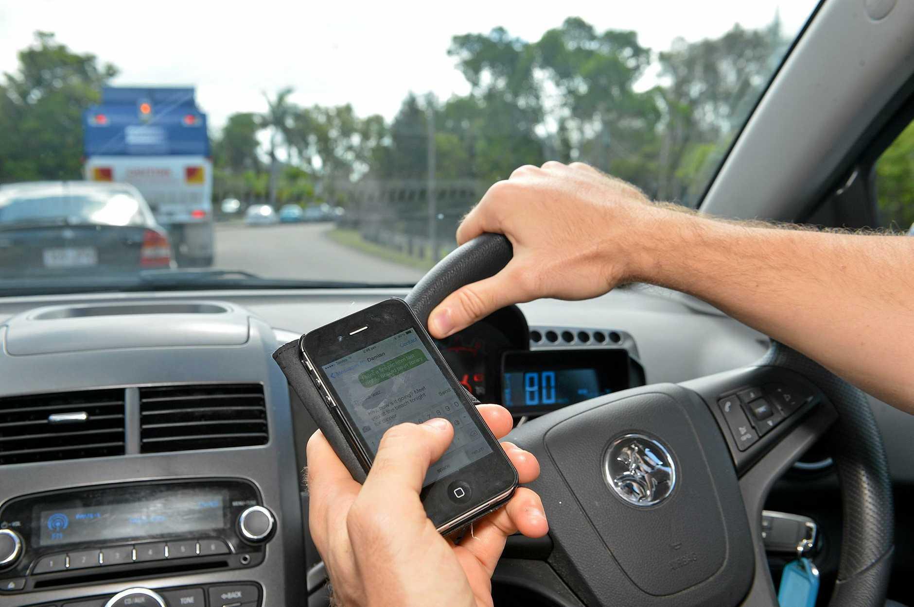 Texting while driving. Photo: Warren Lynam / Sunshine Coast Daily