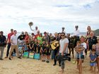 WORKING THE CROWD: Rainbow Beach locals greet Sam McMillan and the 'Sunrise' crew yesterday.