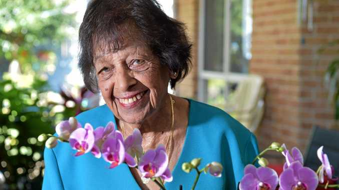 BUSY BEE: Anna Choolun has recently turned 100 but is exceptionally active for her age. She is pictured with her favourite orchid.