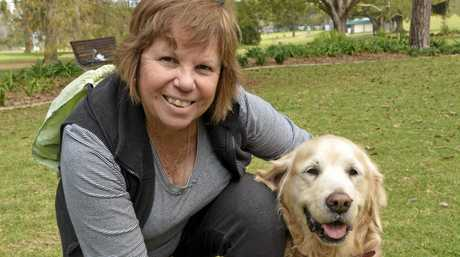 Robyn Palton with 13-year-old golden retriever Molly.