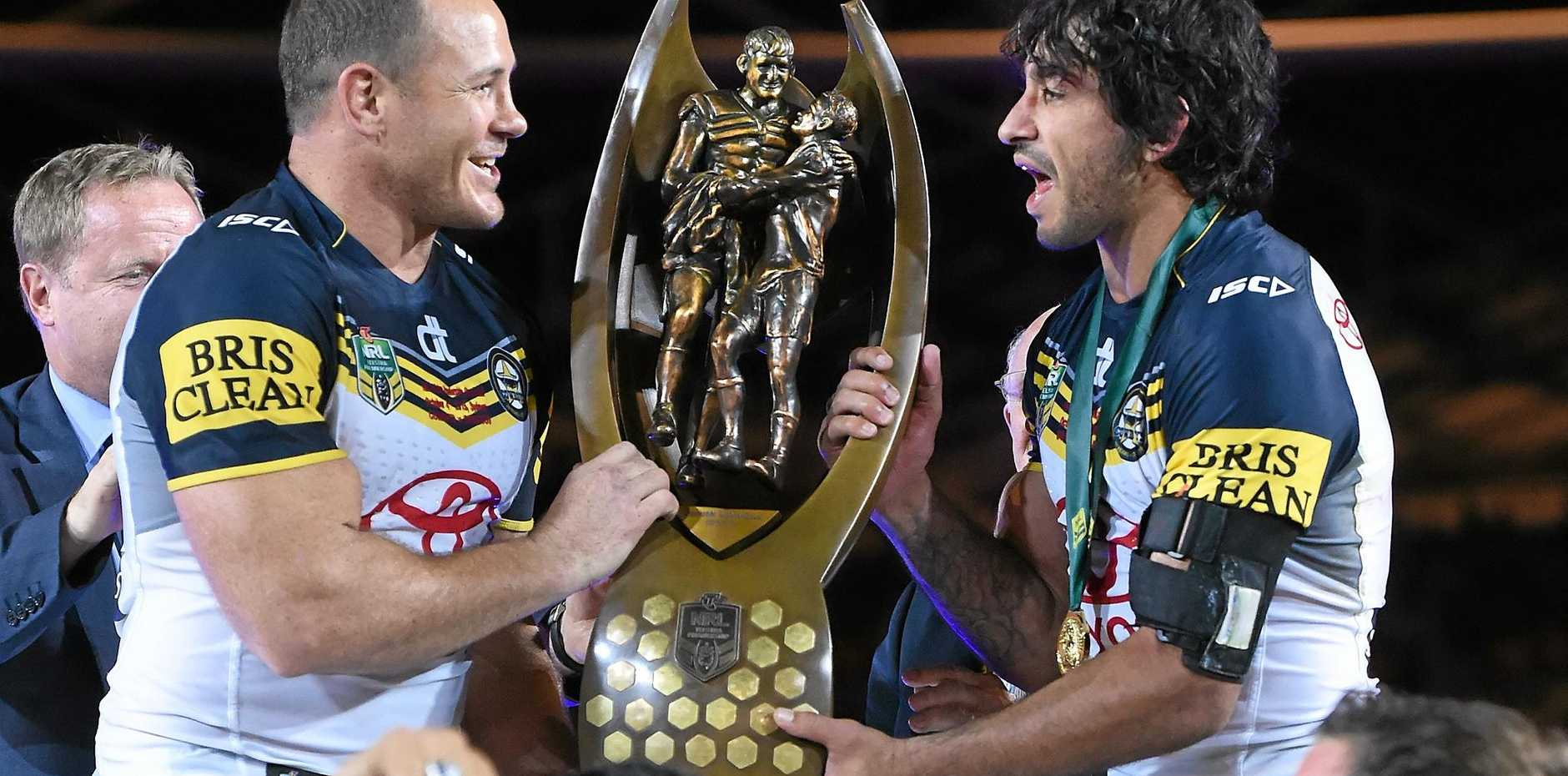 ULTIMATE PRIZE: Cowboys co-captains Johnathan Thurston and Matt Scott lift the Provan-Summons Trophy for winning last year's NRL grand final.
