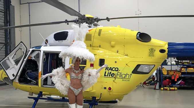 EVERYBODY DANCE NOW: A show girl gets ready for the RACQ LifeFlight gala ball.