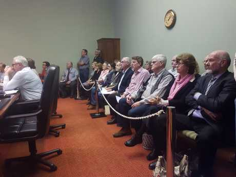 Residents pack into council meeting room to object new Highfields 7-Eleven.