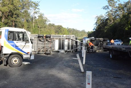Emergency services attend to a caravan rollover on the Bruce Hwy about one kilometre south of the Mons Rd exit.