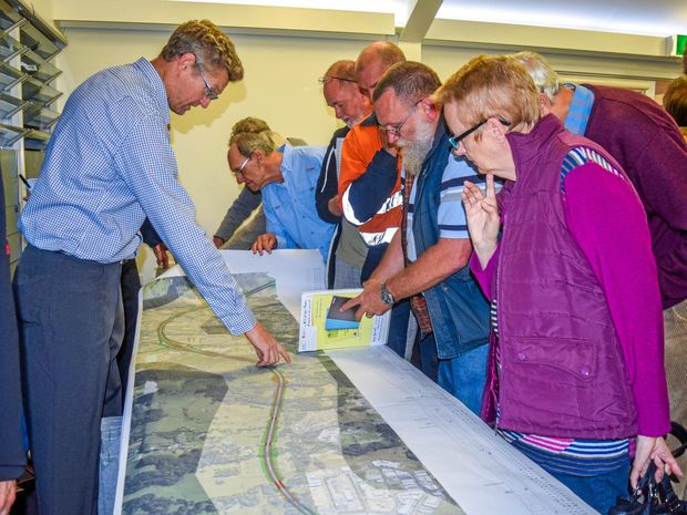 People oberving the plans for the Coffs Harbour bypass at a community drop-in session hosted by the Roads and Maritime Services.