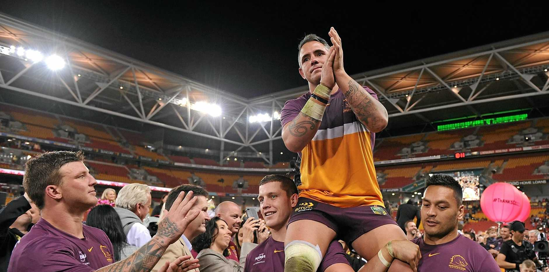 Corey Parker is chaired off the field  at Suncorp Stadium.