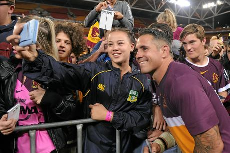 Corey Parker takes a photo with Broncos fans after the round 26 NRL match  at Suncorp Stadium.