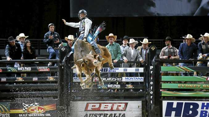 BRILLIANT: PBR rider Roy Dunn fights to hold on to a bull during a recent event.