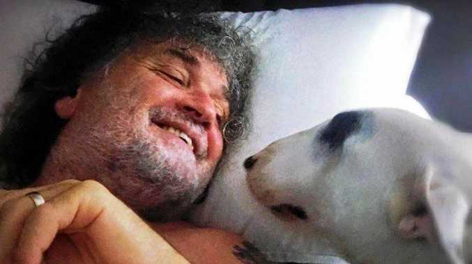 Terry and his canine buddy George. A campaign was started to help train the minature bull terrier as an assistance dog after Terry became a tetraplegic due to a motorbike crash.