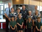 CHANGING OF THE GUARD: Inspector Grant Marcus, Senior Constable Matthew Findlow and Sergeant Meg Owens with St Luke's students Lily Stone (middle left), Justus Rockloff, Danielle Lepatourel, Chika Hibbert, Lillian Tu (front left), Flynn Steffan, Katelyn Taylor, Byron Higgins