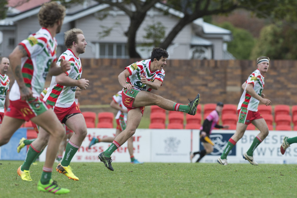 KICKING ON: Pittsworth halfback James Dempsey in action.