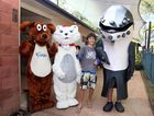 Kurtis Finch, 13, of Hervey Bay meets Fraser the Dog, Poppins the Cat and Hervey the Whale at this year's RiverFest.