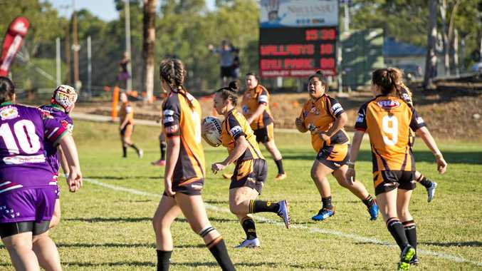 Wallaby's Meagan Wex powers away.