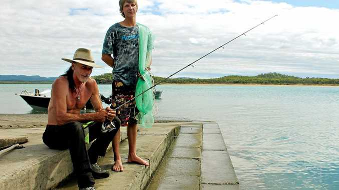 IN SUPPORT: Coconut pickers Hurse Cutler and Shawnee Burroughs agree with the introduction of recreational fishing licences.