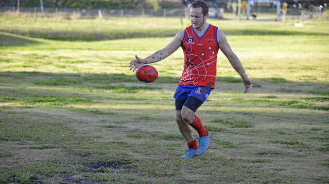 GREAT YEAR: Tyhe Clarkson gets a kick for Warwick in AFL Darling Downs men's action.