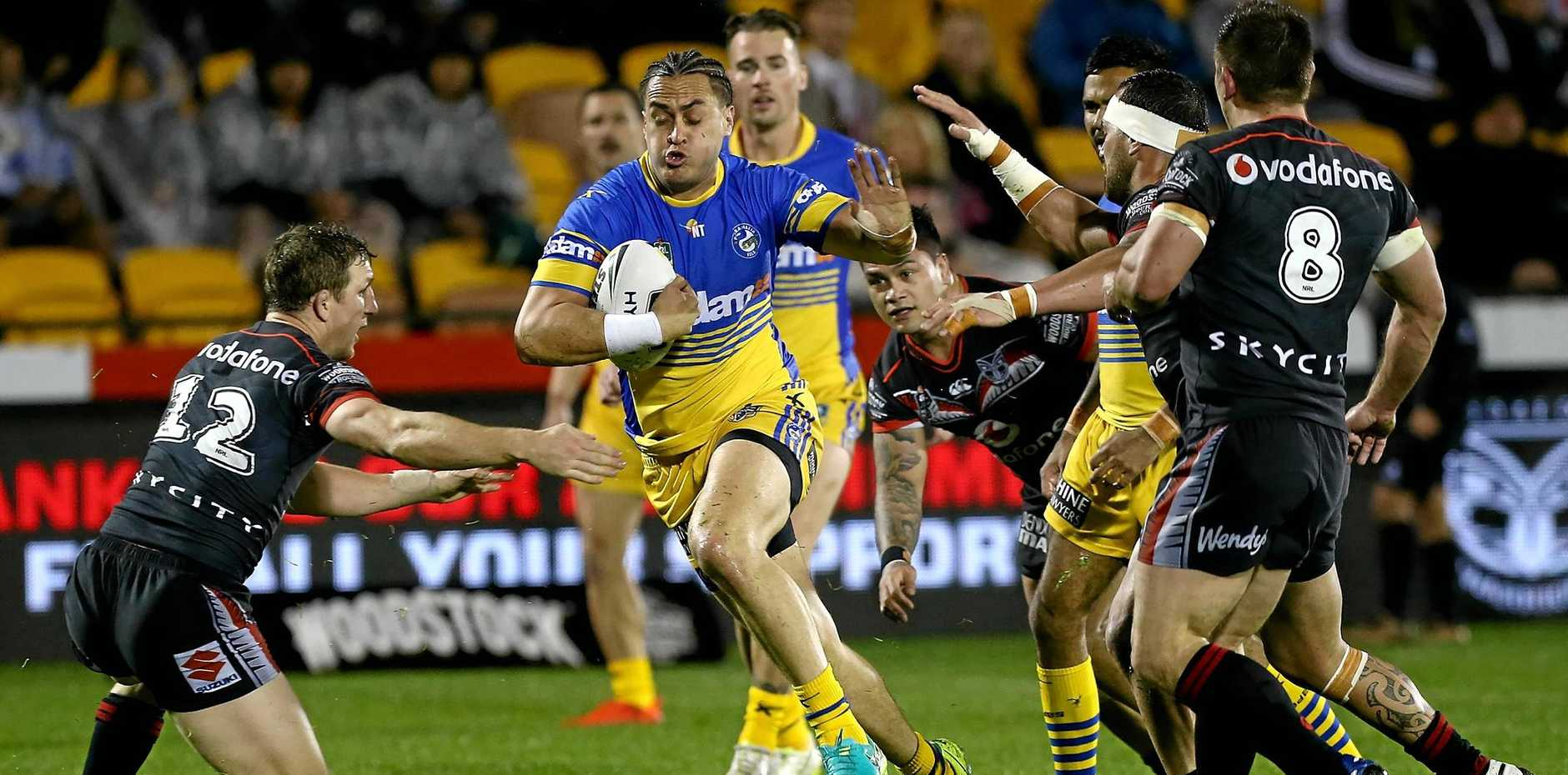 Captain Ryan Hoffman of the Warriors challenges Brad Takairangi of the Eels  at Mount Smart Stadium in Auckland.