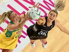 Jane Watson of the Silver Ferns and Caitlin Bassett of the Diamonds compete for the ball.