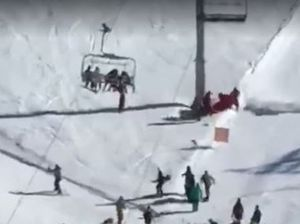 """Scary"" fall for boy after dangling from ski chairlift"