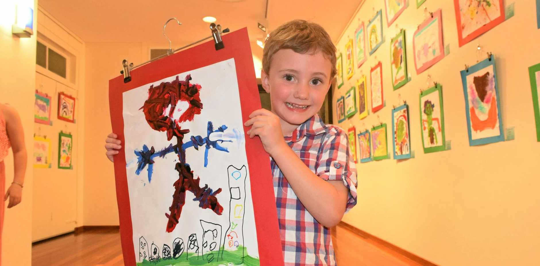 WEB-SLINGER: Young Lucas Shephard has an obsession with Spider-Man, so it's no surprise he painted his hero for the C&K; Maranoa Community Kindergarten Art Exhibit on Friday night.
