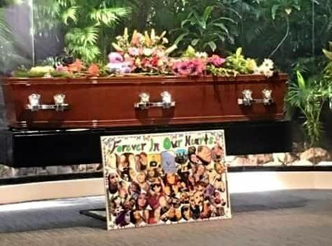 A photo board rests in front Demmi Barr's casket at her funeral in Caloundra on Friday.