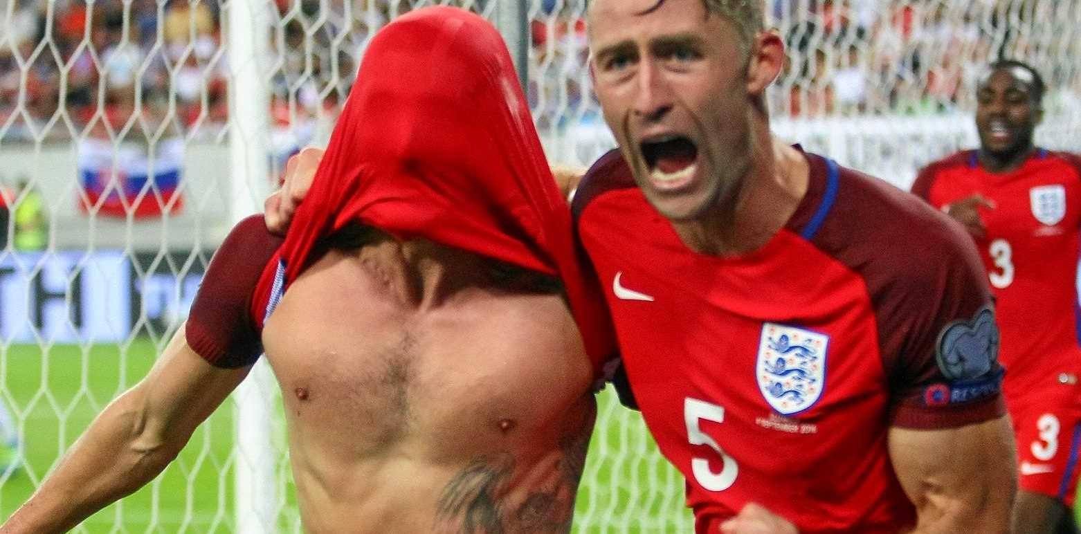 Gary Cahill (right) and Adam Lallana of England celebrate after Lallana scored a late winner against Slovakia.