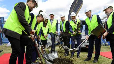 Officials turn the first sod at the site of Dusit Thani Brookwater Golf and Spa Resort.