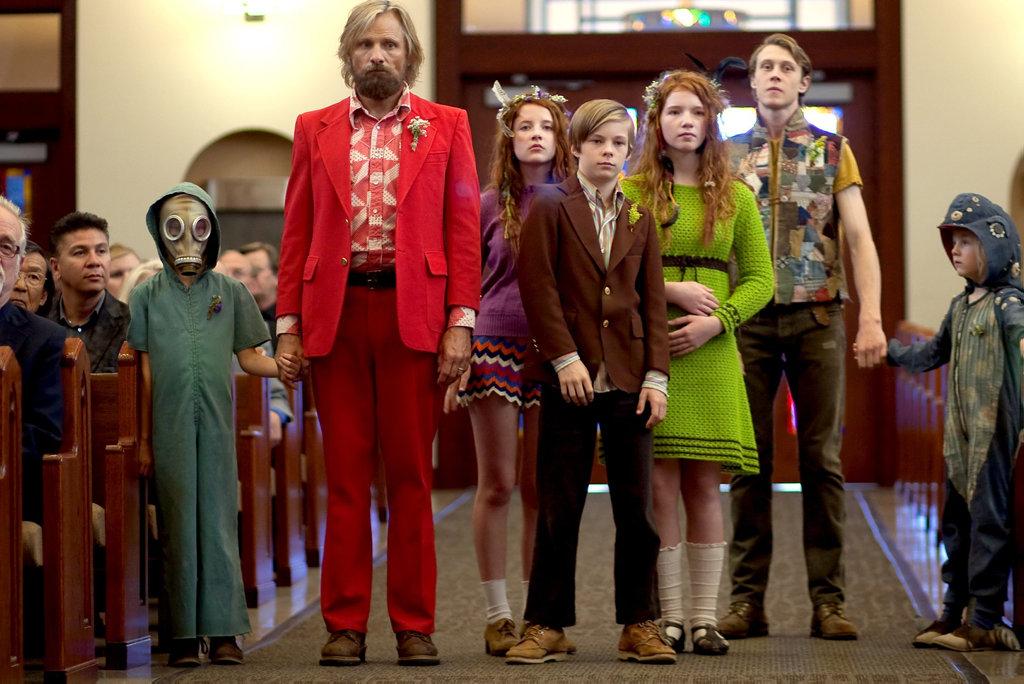 From left, Charlie Shotwell, Viggo Mortensen, Samantha Isler, Nicholas Hamilton, Annalise Basso, George MacKay and Shree Crooks in a scene from Captain Fantastic.