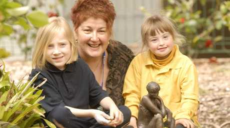 SIGNING OFF: Toowoomba West Special School (left to right) Bronte Munt, Principal Lea Formigoni and Jazmyn Wilson in 2010.