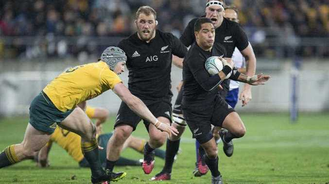All Blacks halfback Aaron Smith, right, sidesteps Australia's Ben McCalman during the Rugby Championship test played at Westpac Stadium in Wellington, New Zealand, Saturday, Aug. 27, 2016.