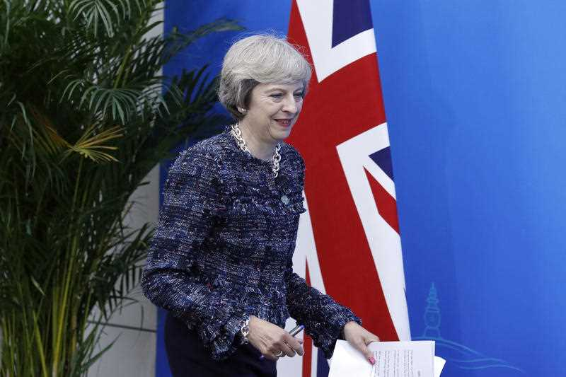 British Prime Minister Theresa May arrive for a press conference held at the end of the G-20 summit in Hangzhou in eastern China's Zhejiang province, Monday, Sept. 5, 2016.