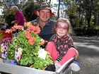 BLOOMIN' MARVELLOUS: Snatching up bargains at Pohlman's Nursery 40th Birthday is Jason and Georgie Sabburg.