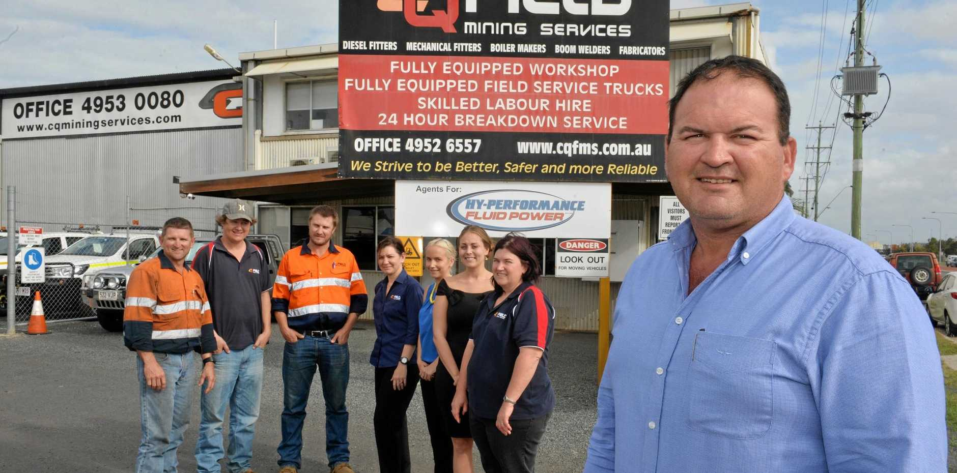 CQ Field Mining general manager Dean Scott (right) and his staff at Paget (from left) Danny Chrzanowski, Liam Keighran, Jason Holt, Julie Hope, Kirsty Head, Sara Aston and Sharon McLean.