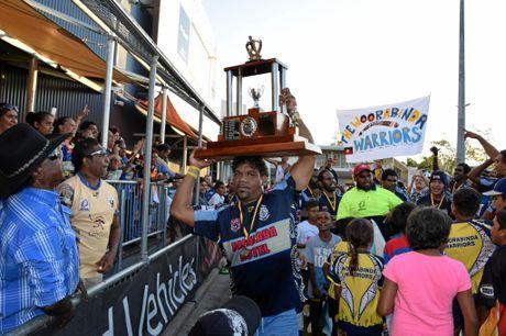 Club stalwart Jack Bond lifts the trophy,