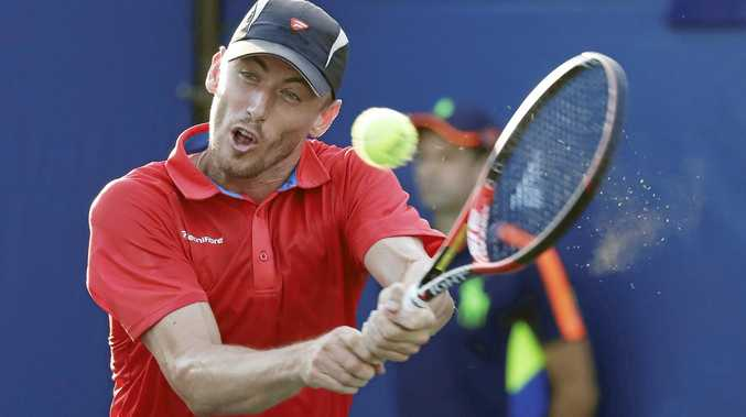 John Millman of Australia hits a return to Dominic Thiem of Austria on the second day of the US Open.