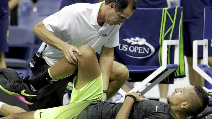 Nick Kyrgios, of Australia, is checked by a trainer before the start of the third set against Illya Marchenko, of Ukraine, during the US Open.