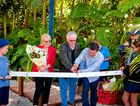 COMMUNITY EFFORT: Coolum Beach Christian College students and author Brian Andrew and his wife Moira cut the ribbon with primary teacher Jon Northwood to officially open Grandad's Garden.