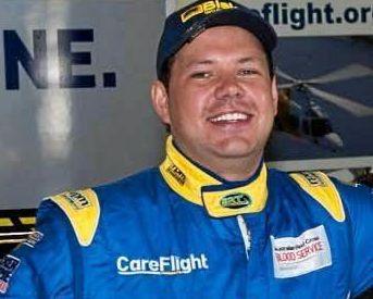Colin Sieders in car racing gear.