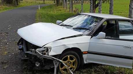 WRITE OFF: Unregistered car abandoned on Stony Chute Road after a young driver crashed it while overtaking on a corner.