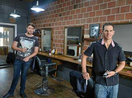 Barber Matt Harper and owner of Razor's Edge owner Darren Purdy.