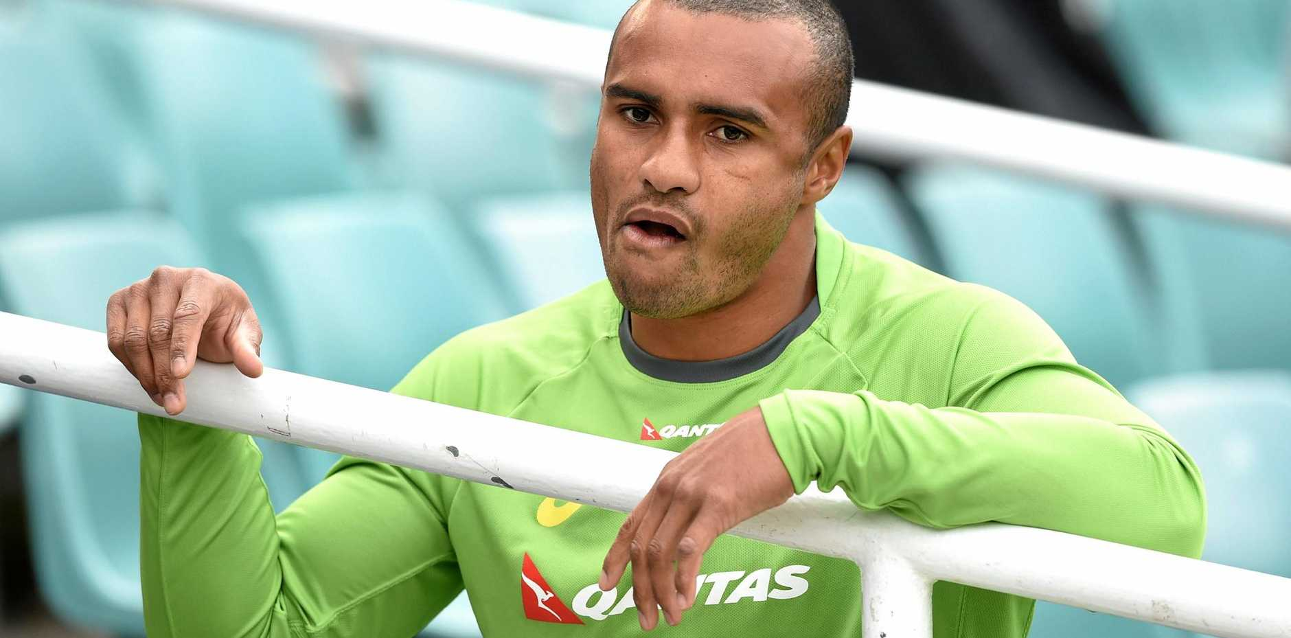 Australian rugby union player Will Genia arrives for a Wallabies training session in Sydney.