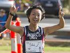 FINISHING FEELING: Rina Wakasugi celebrates winning the Ridge To Ridge Half Marathon women's race last year.