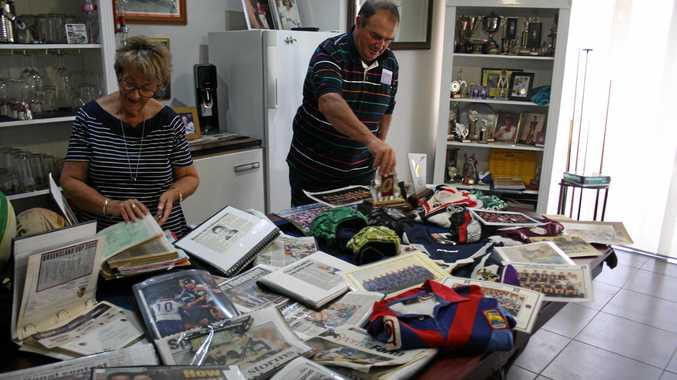 MEMORABLE MOMENTS: Sandra and Tom Friend look through newspaper clippings and memorabilia from their son Nathan Friend's rugby league career, some of which was washed away in the 2011 floods at Grantham but found more than a week later.