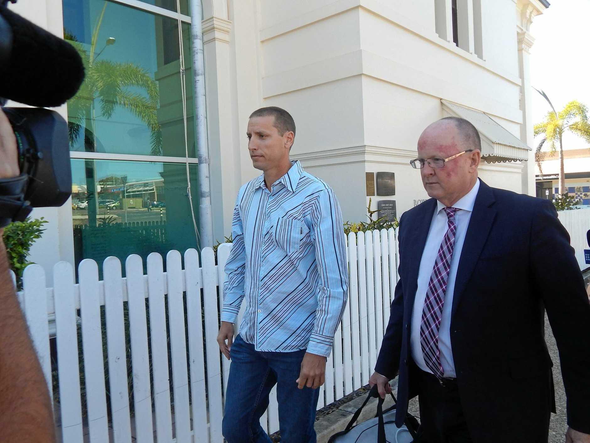 Robert Hytch (left) arrives at Bowen Court in September, 2014.