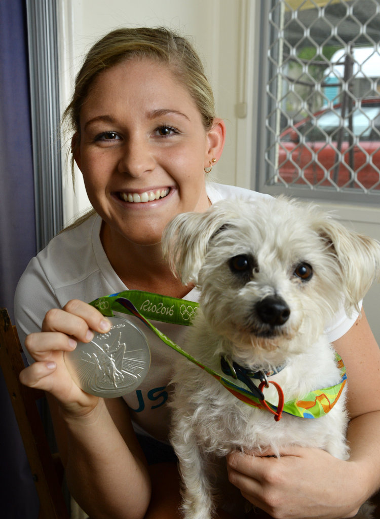 Leah Neale is back in Ipswich after winning a silver medal at the Rio Olympics. With dog Scruff.
