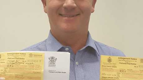 Speeding motorist Tim Kelly holding the two fines issued by the Whitsunday Police.